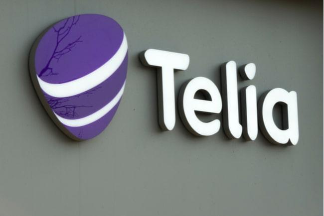 Vägg med Telias logotyp